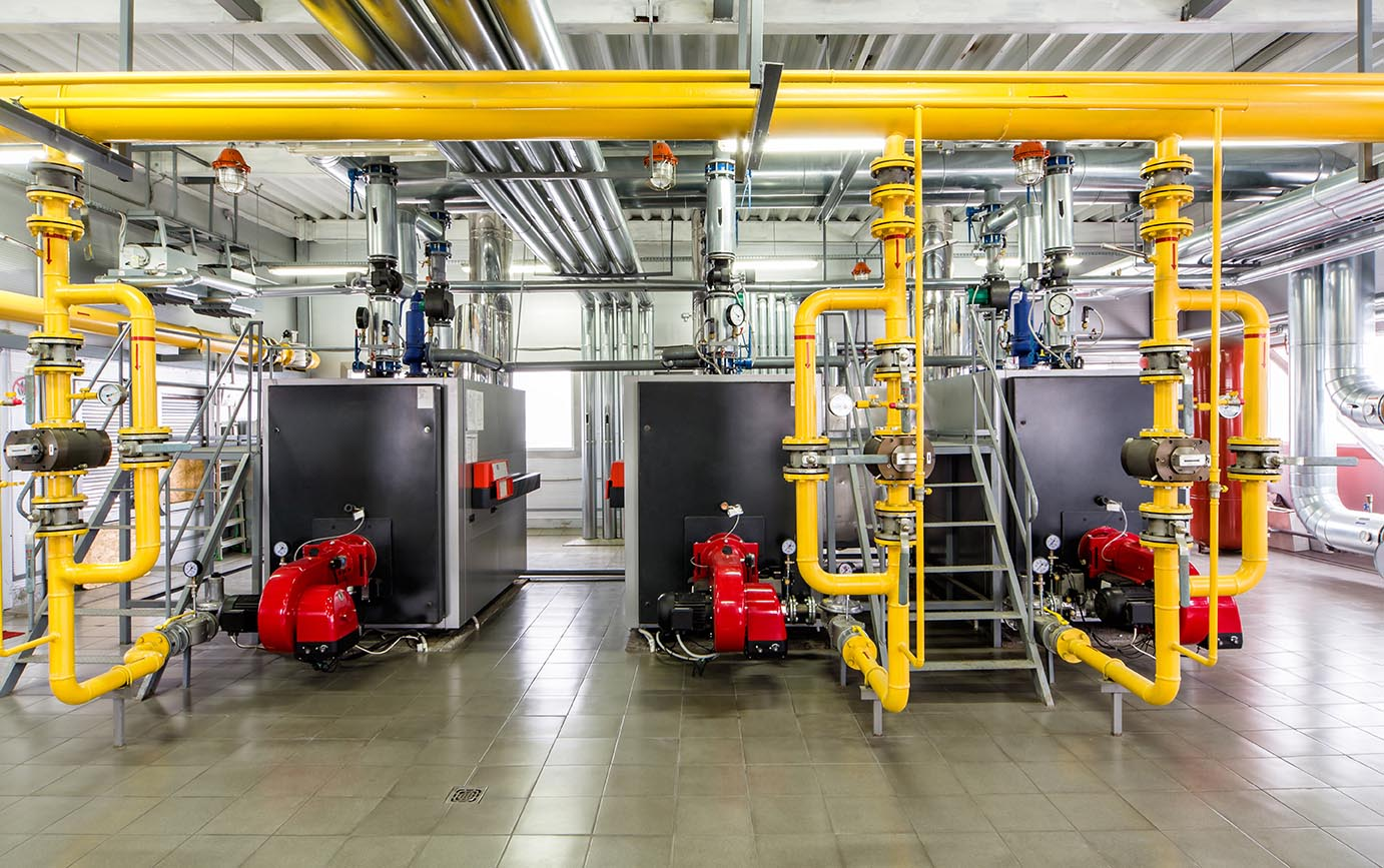 fastnet-service-facility-management-telenova-imm-2 - The interior of gas boiler, with three boilers.
